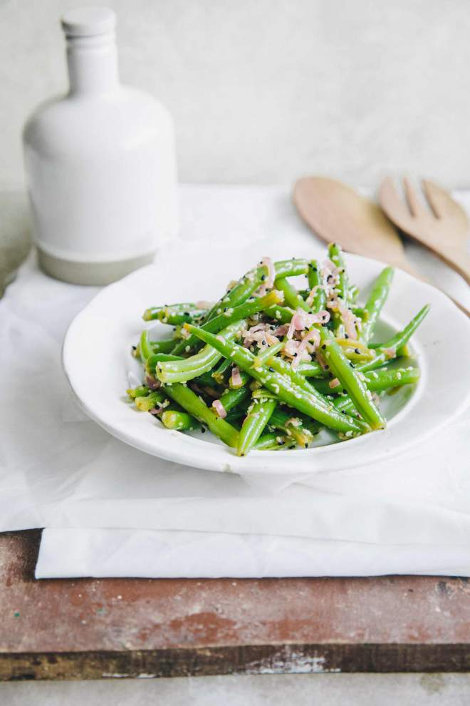 String bean salad with sesame seeds served in a bowl