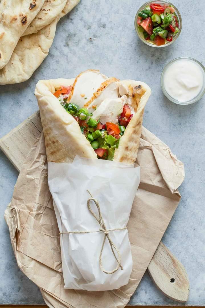 Chicken wraps with fresh salsa and yogurt served in a flatbread