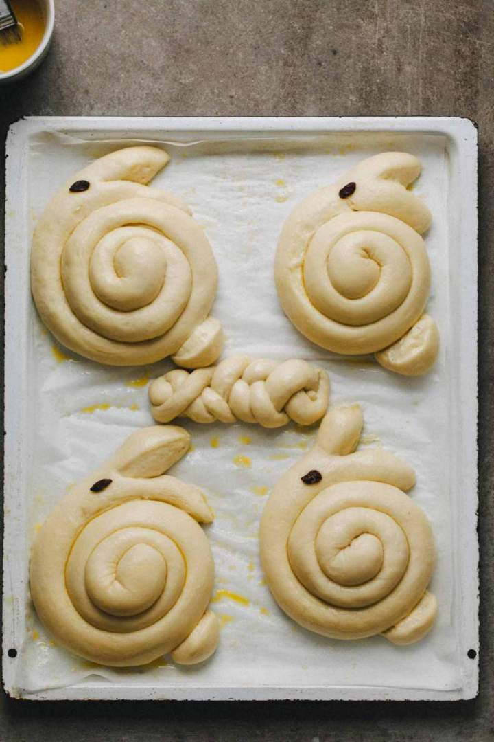 Shaped Easter bunny shaped rolls before baking
