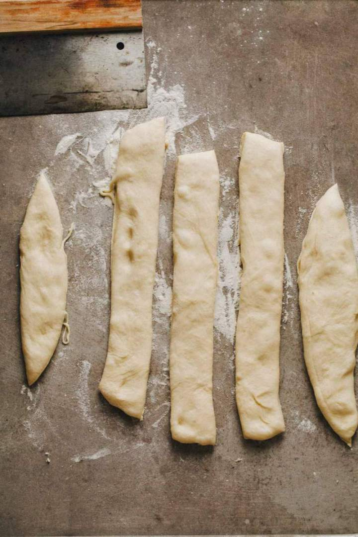 Five pieces of dough for Easter bunny shaped rolls