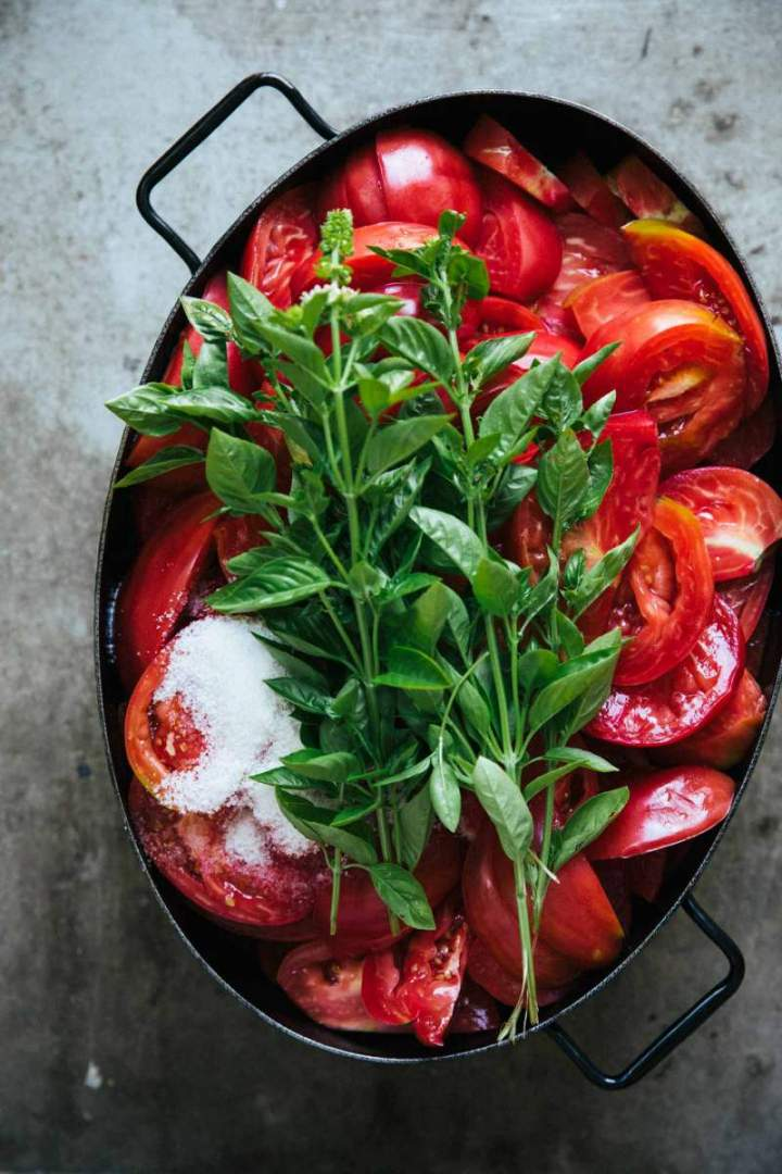 Fresh tomatoes and basil in a large pot